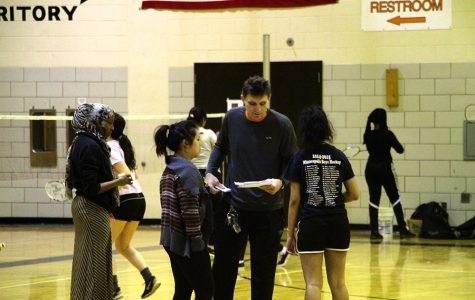 Badminton coach intercepts head football position