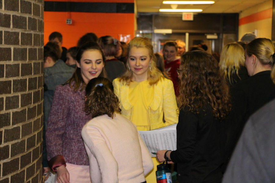 Pictured above cast and crew members rush out to hug friends, and family after the Friday night performance of 'How to succeed in business without really trying.' Due to concerns with the original plays misogyny, all roles were gender swapped for the South High performances. Photo: Izzy Willette