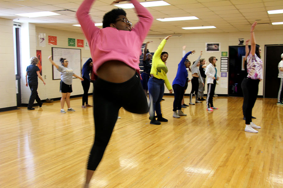 "Being black in America right now is a complicated experience. ""Sometimes it's good and you're feeling it but other times you're scared and other times you're angry it's like going through a whole range of emotions at once like there's no emotion to explain it,"" explained sophomore Elise Cuff. Here, Cuff relaxes in her dance class."