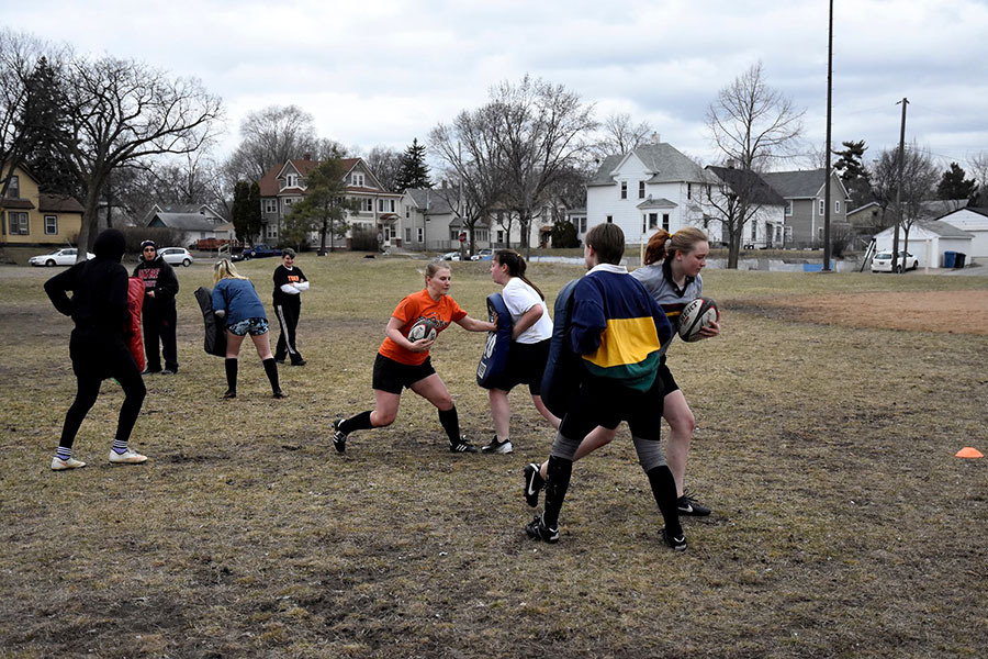 As pictured above, rugby players participate in an activity where they run with the ball, hitting blockers (similar to those used in football) as they go. Players also practice strategies that they can implement during games, such as rucking. This is when players push against each other to get the ball out of a pack, so someone else can grab it. Photo: Sophia Manolis