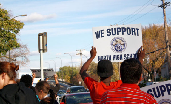 North High supporters rally outside the school board meeting on October 12.