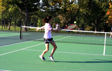 A JV player takes a swing during a match against Wayzata.