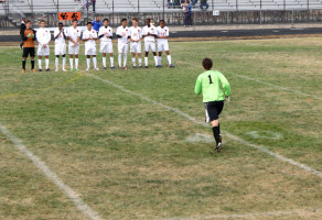 Senior Miles Westrich runs to meet his team on the field.