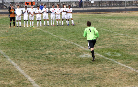 Senior Miles Westrich runs to meet his team on the field.
