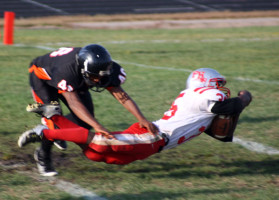South football player shows Patrick Henry who's boss. Photo Credit: Emmet Kowler