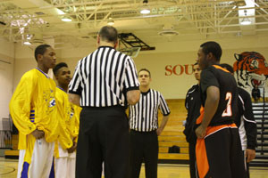 South men's basketball captains Isaiah Wilson and Mahari Wilson participate in the coin toss prior to a recent game. against Edison. Coach Joe Hyser feels that a captian's job is to be a leader and spokesperson for the team.