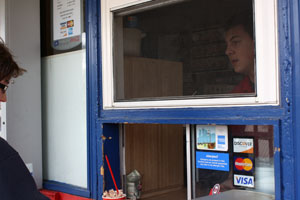 Junior Max Pellinger takes orders from the Dairy Queen drivethrough where he woks. Photo: Sophie Downey