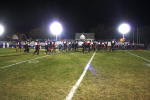 Students Cheer for Football with Lights