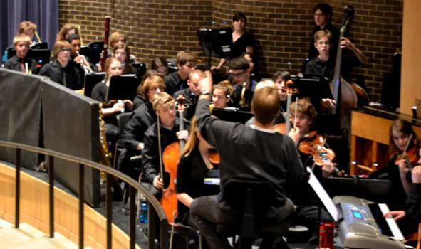 Student musicians accompany musical from off stage