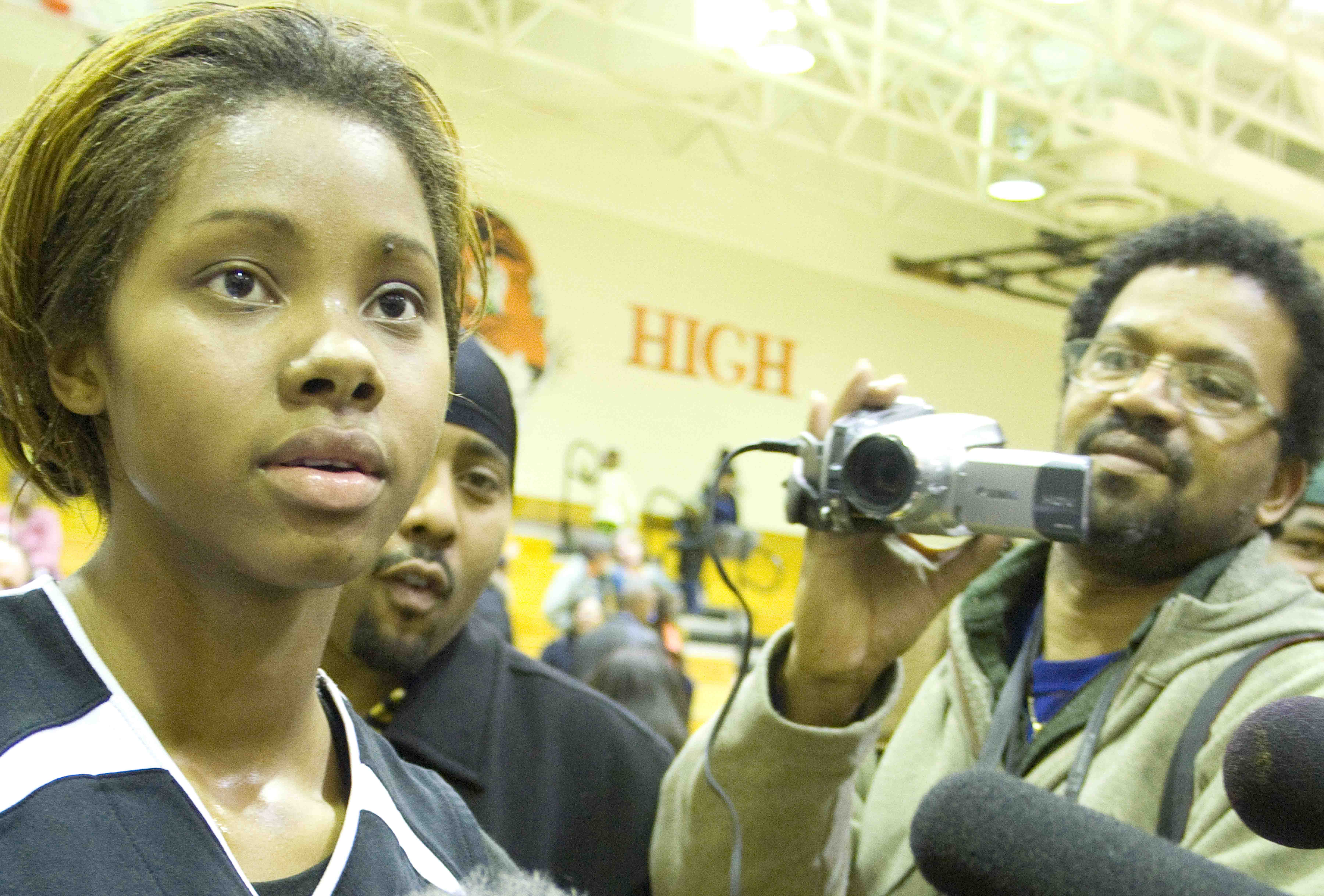 Tayler Hill is swamped by the press after a game during her senior year at South in 2009.