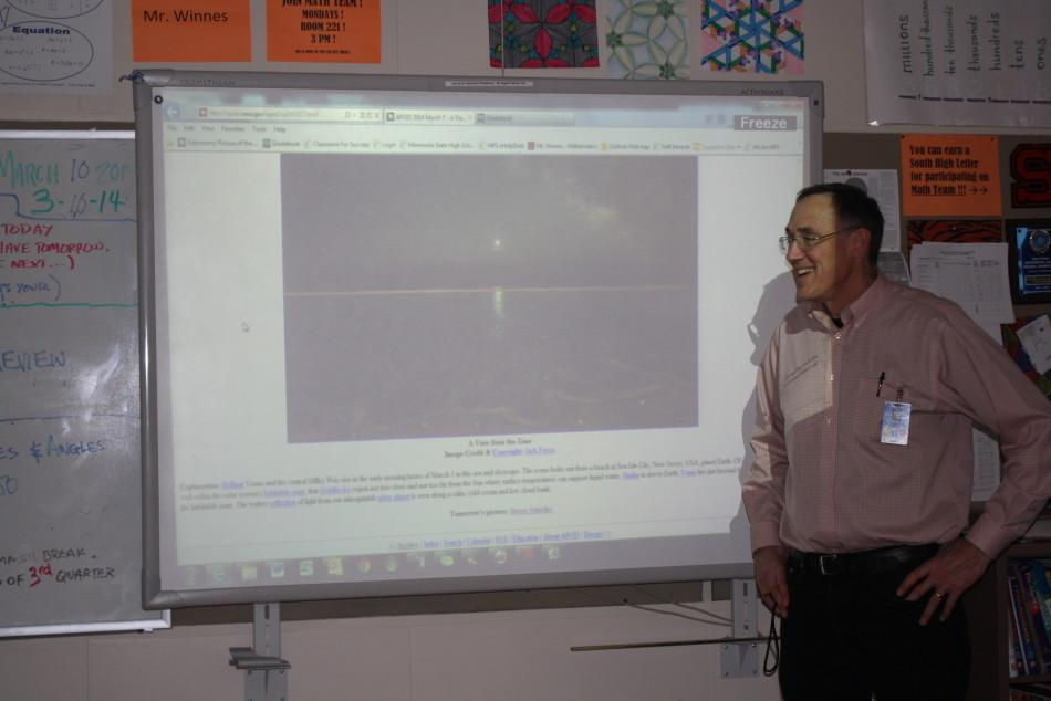 Math teacher Don Winnes shows his sixth hour class the astronomy picture of the day. Winnes gets these daily photos from apod.nasa.gov. Today his picture featured Venus and the Milky Way.