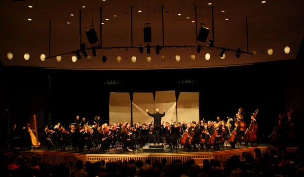 "Playing in a high school isn't so different from Orchestra Hall, Arnstein explained. ""The stage is a little smaller . . . and the lights are a little more glary . . . we adjust to the acoustics always."""