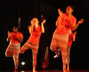 Senior Dakessa Hector, junior Alicia Bierauer, and sophomore Fanta Diallo perform in a West African dance piece choreographed by Kenna Camara Cottman. Cotman believes that sharing of cultural traditions promotes cultural understanding and acceptance.