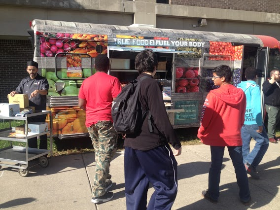 Second lunch students take advantage of the food trucks stationed outside the school on October 14th. Food such as orange chicken was offered to south students during all three lunch periods.