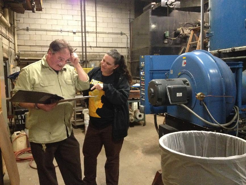 Engineers check the water temperatures of the boiler. They must test the boiler twice a day to ensure its wellbeing.