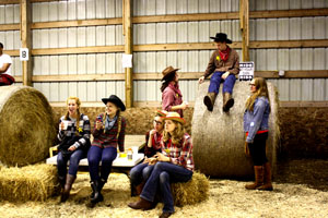 A group of sheriffs look on as students square dance. From left to right is Makaia Frober, Amber Cordes-Eklund, Sofie Everetts, Becca Krasky, Johannes Carlsen, Joey Flora, and english teacher Elizabeth Hanson.