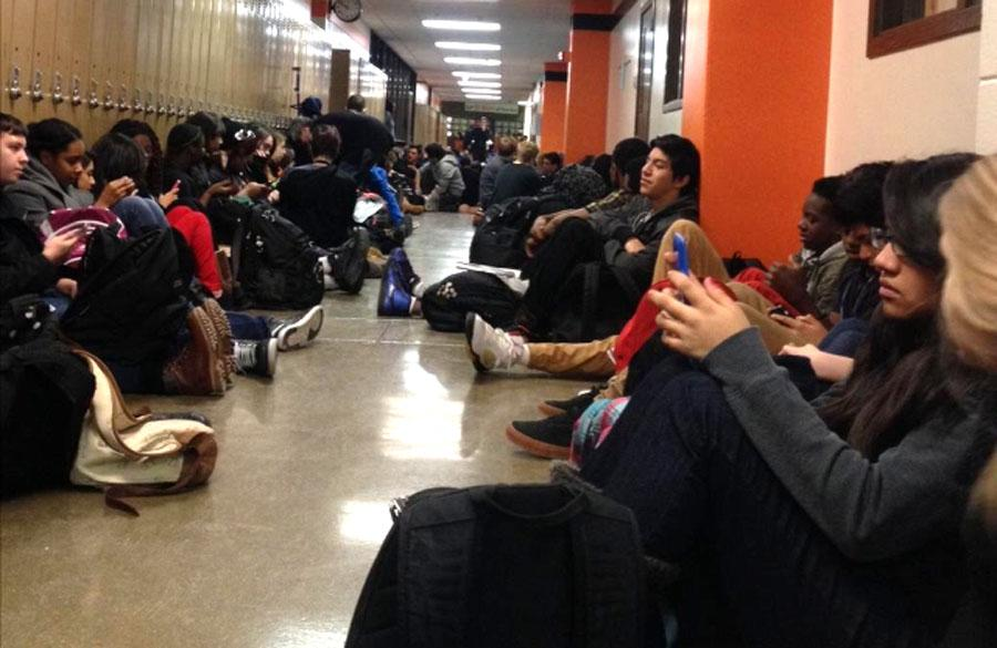 Hundreds+of+students+sit+in+front+of+the+main+office+in+protest+of+the+decision+not+to+indict+Darren+Wilson.