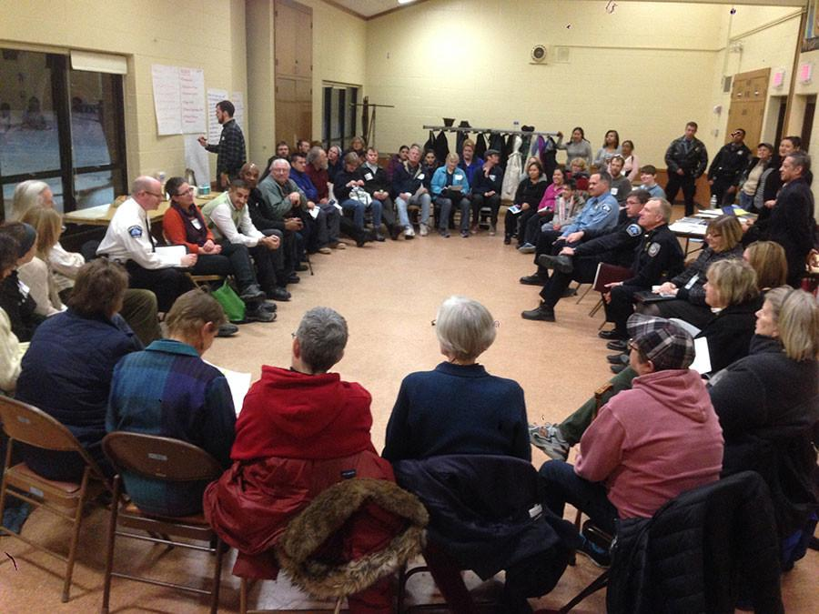 Community members meet in Corcoran Park to discuss a plan of action following a recent outbreak in crime. Here they are brainstorming ideas to make the community safer. Courtesy of Eric Gustafson