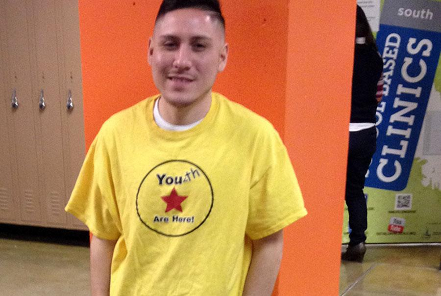 Youth are Here team members like Ramiro Vazquez can be spotted at roaming the halls in their bright yellow shirts at passing time or greeting students in the commons. Photo: Grace Palmer