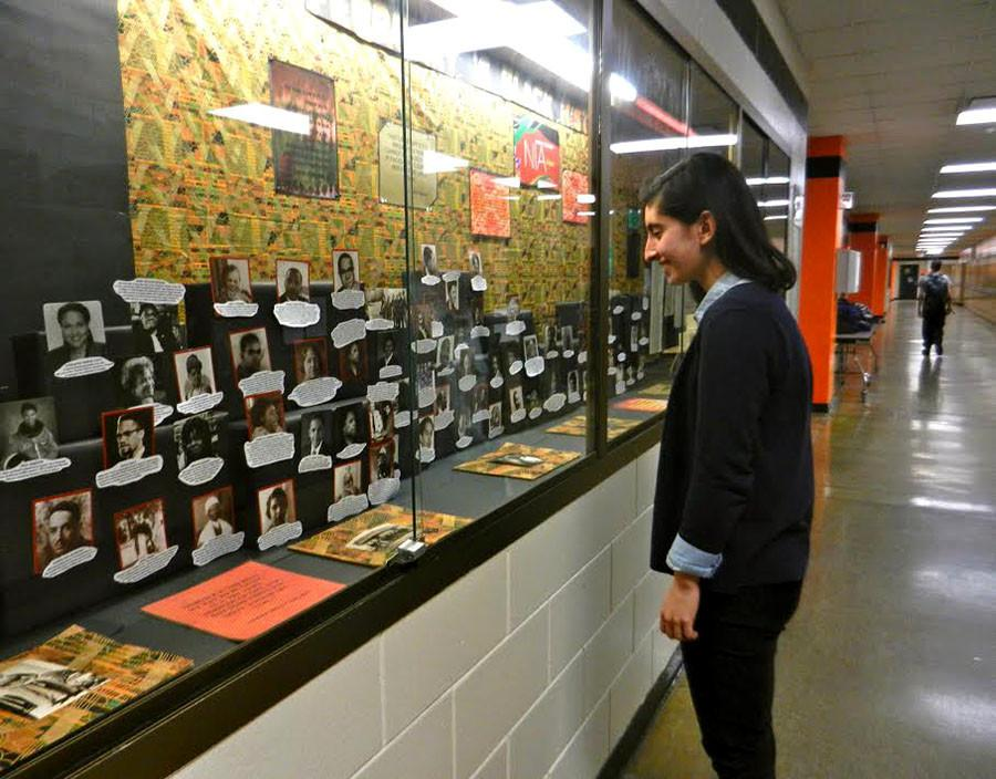 Junior Nahal Javan looks at the Black History Month display near the front office.