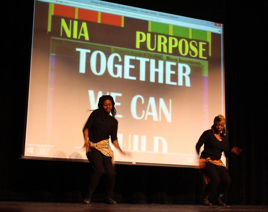 Two UMOJA students dance. Pictured left to right: Senior Joy Adebanjo and senior Vivi Campbell