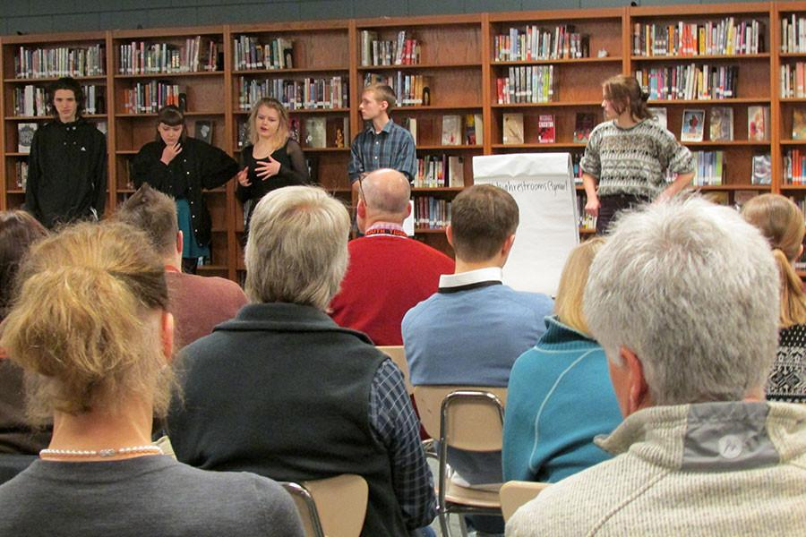 Juniors Sidonia Zinky, Chris Mann, Aidan Denison, Rex Otto and Soline Van de Moortele present their plans for gender neutral bathrooms to the South staff meeting.