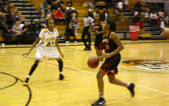 Morgan Hill dribbles the ball towards the basket. Hill plays the majority of the time, in most games, and scores an average of 20 points a game.