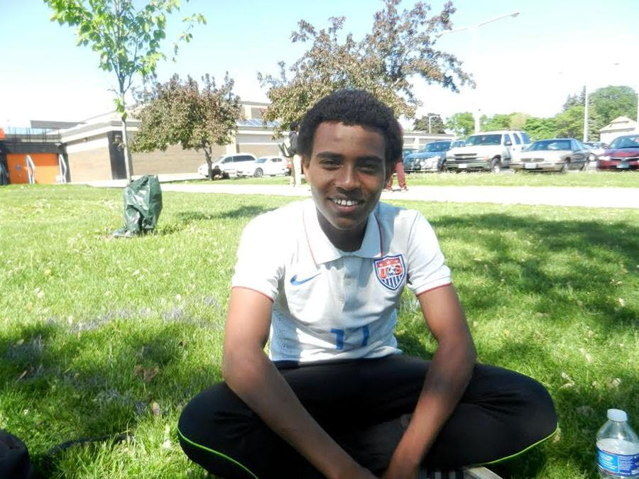 South senior Umar Hassan sits peacefully on the South lawn. He won the Gates Millennium Scholarship, which will give him a full ride through college and graduate school.