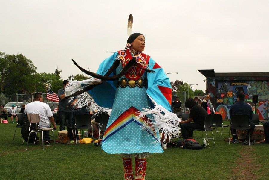 A guest dancer spins during a two-step dance.