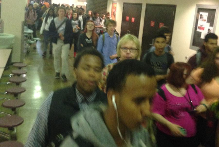 10:30 - Around 200 South students gathered in The Commons to walk out in solidarity with the MOA 11.