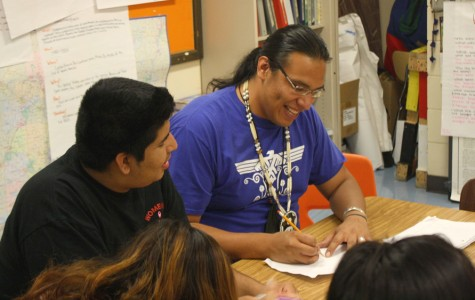 Butler helps Abel Martinez conjugate Ojibwe verbs. Though he only started at South this year, he talks to his students like old friends.