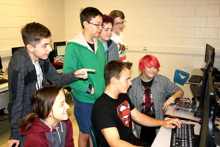 Christian Wanek (12) explaining some coding to a group of freshmen.