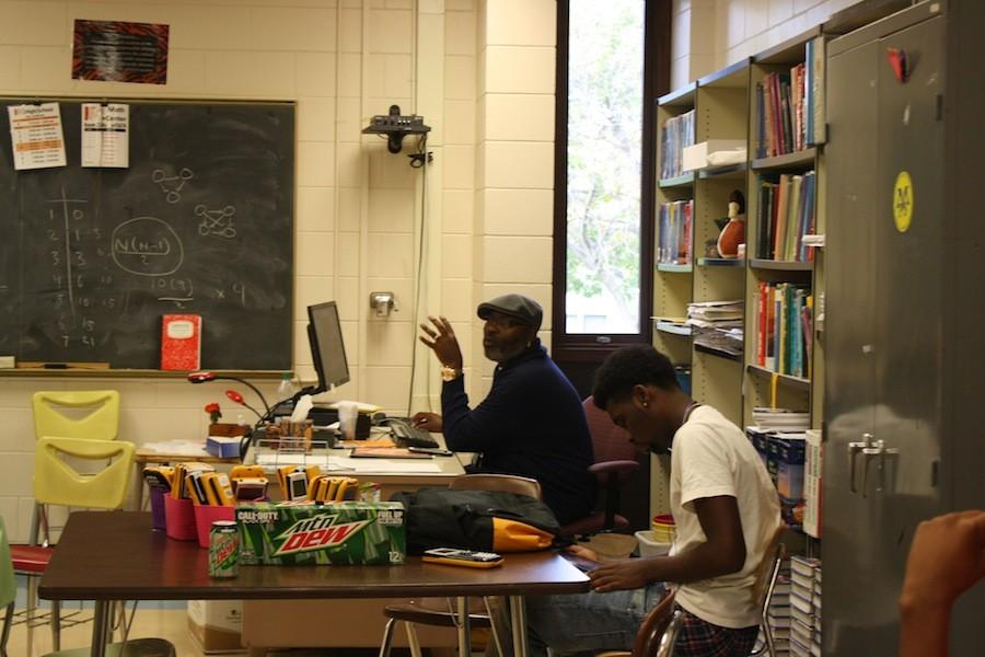 Teacher Corey Yeager instructs senior Malik Overton and other students in the B.L.A.C.K. course, a new class at South created for African American male students. According to Yeager, the goal of the course is,