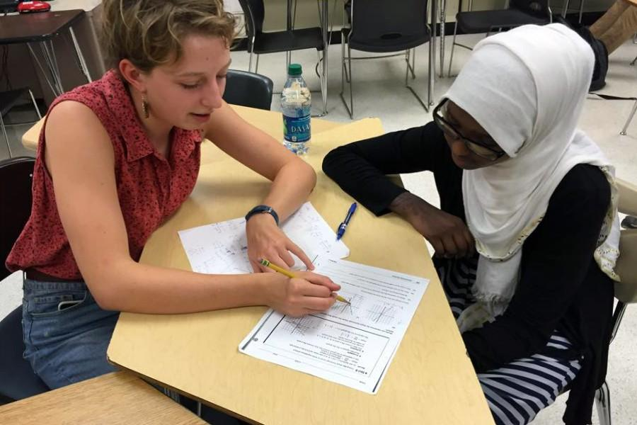 Math tutor Laurel Nuefeld, senior, helps freshman Ayun Sahul with her math homework. The Math center has helped over a thousand students this year alone, and the numbers of students coming in are growing as well as school performances.