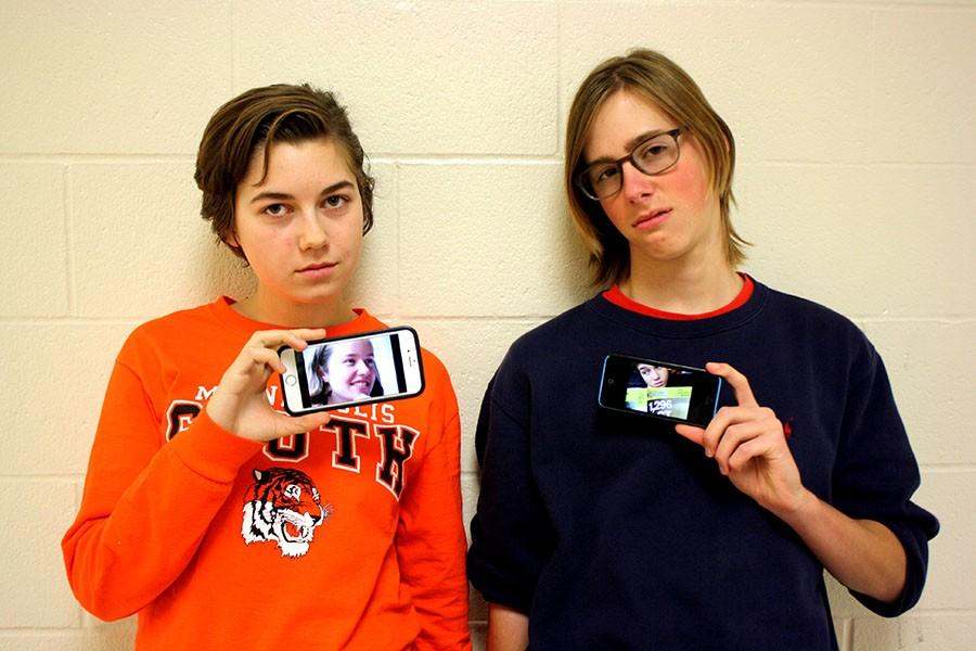 Izzy Rousmaniere and Nick Jensen holding up pictures of Mairead Howley and Sophia Breitag-Makeever. All of the four students take some amount of PSEO classes so getting them all together is near impossible.