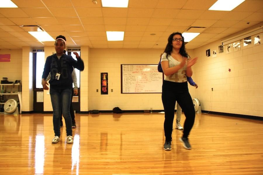 "Jermartha Reese (9th) and Sabrina Lagos (10th) practice their hip-hop dance for the all-original dance and spoken word production on Thursday, November 19th. The free performance will start in the auditorium at 7:30pm. ""I hope that [the audience likes] that we did something else and be inspired,"" Ayala said."