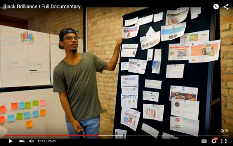"""South graduate Michael Arnold gives a presentation in this screencap from the documentary """"Black Brilliance,"""" about five black students journeys to graduation."""