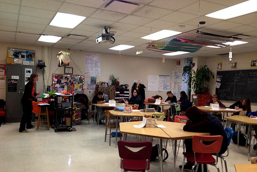 Stephanie Woldum explains linear relationships to her seventh hour class.
