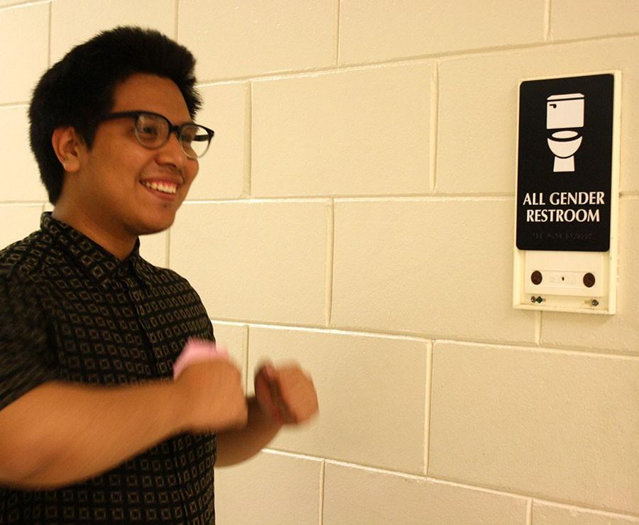 Senior Brandon Castro-Venancio traipses happily into the all gender bathroom, a perfect example of the joy and comfort this resource has the potential to bring.