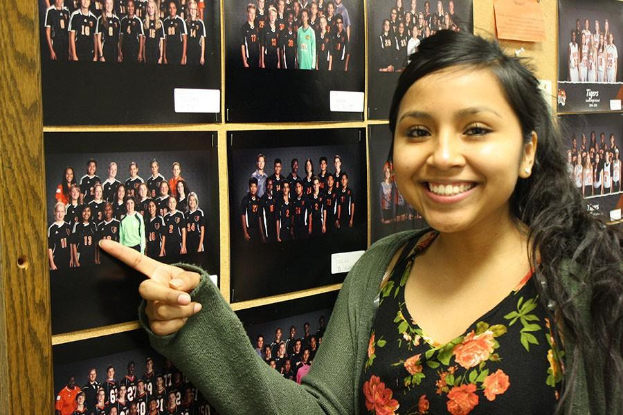 Senior Harmony Chino points to her soccer photo. Unlike most varsity players, Chino started playing soccer freshman year. She is part of the AVID program and balances school, friends and sports gracefully.