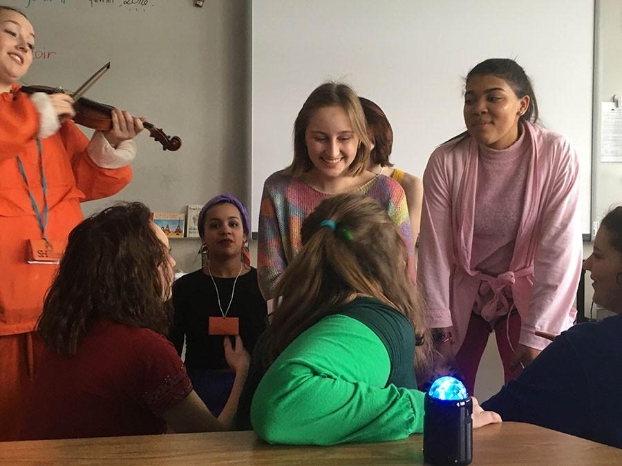 Newspapers feature editor Eva Shellabarger gets serenaded by one of the many singing telegram groups.