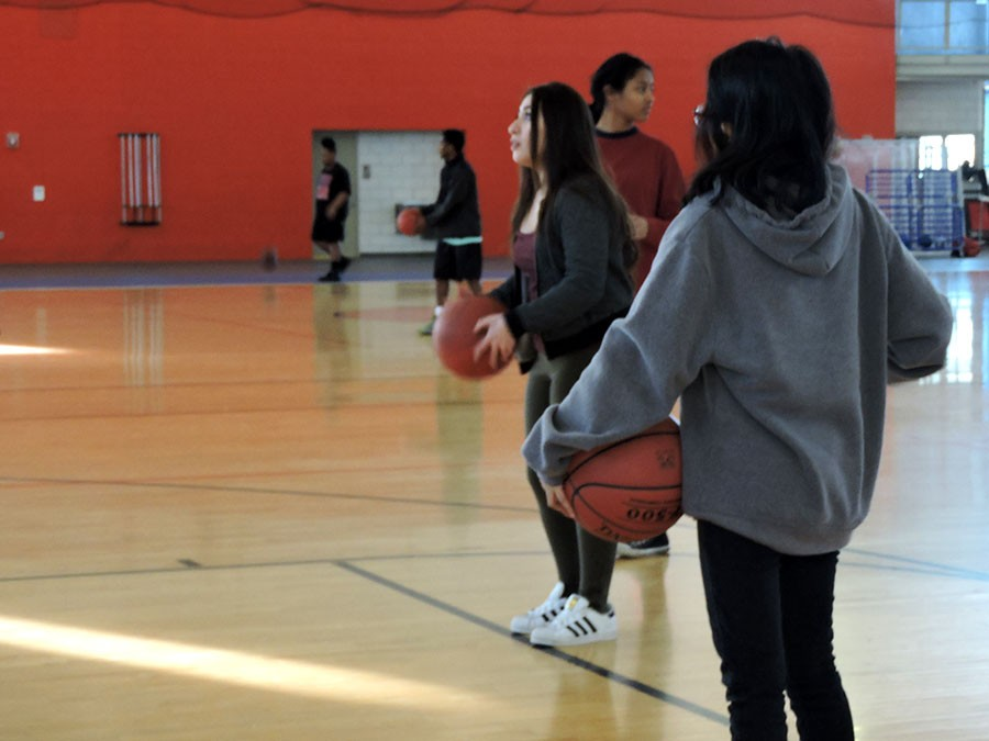 Students in Ms. Fields Fitness for Life class practice shooting baskets at the YWCA.  Photo: Sera Mugeta