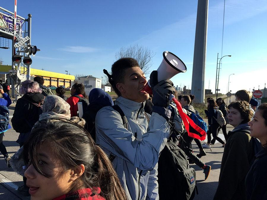 Senior Isak Douah leads a chant at a South walkout for Justice for Jamar. Douah is known for his work in social justice in the Minneapolis area.