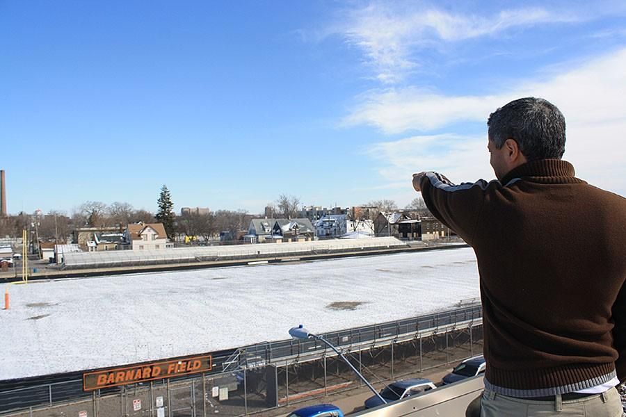 Principal Ray Aponte gestures to the properties lining 21st street which the district has buying in anticipation of the relocation of the Transition Plus building. Aponte was initially excluded from the planning meetings, but he insists that his hopes for the future of South Athletics be considered in the process.