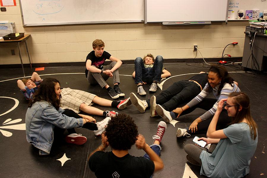 The cast of Diary of Anne Frank laugh after doing a warm up exercise which entails sitting and a circle and counting one by one. In order to be successful, no two people can say the same number, and the cast must listen to each other.