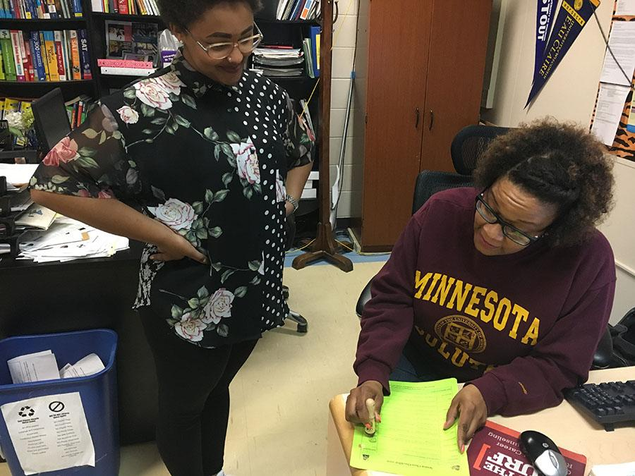 Senior Betty Mfalungundi gets a stamp from Nneka Abdullah, a CCC coordinator, to complete her senior check list. The checklist is one of the many things seniors need to complete in order to graduate. Photo: Paulina Poehlman