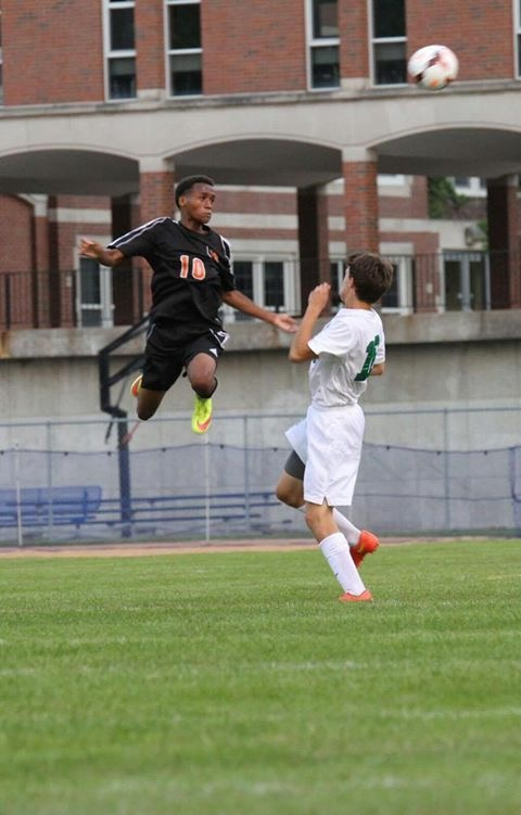 Hamzard Abdul performs a stunning header in a men's soccer game. Abdul was selected to play in the Minnesota all-state team.