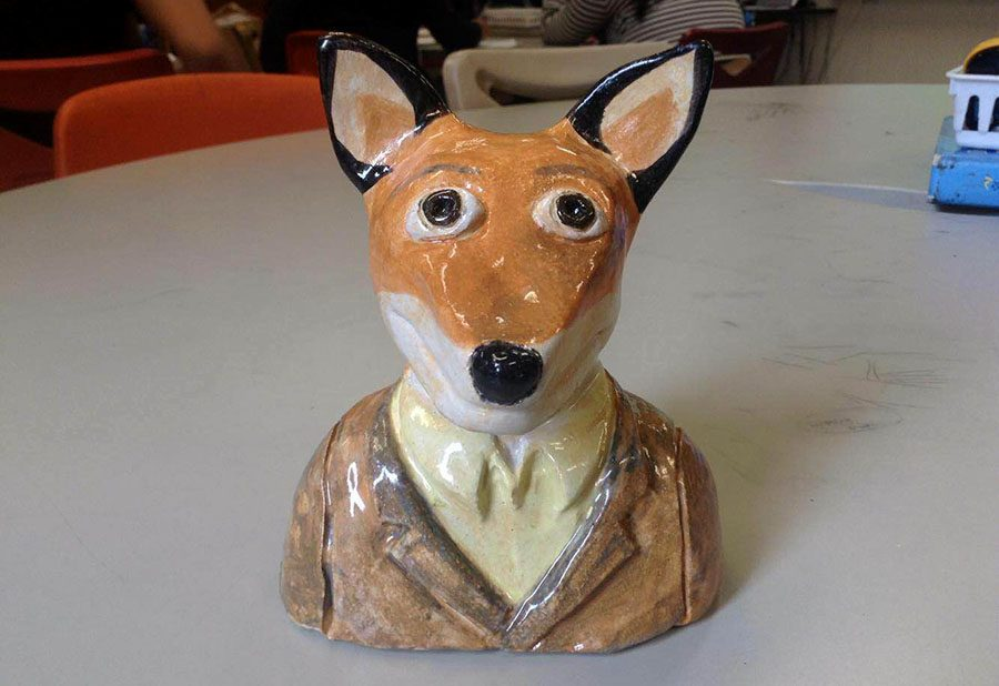 """Sculpture by Senior Mia Dusak, titled """"Fantastic Mr. Fox"""". Dusak says she mainly intends to pursue photography and hair styling in her future, cut that ceramics still might be part of it. """"I think maybe when i'm an old woman i'll get a little wheel and just make some pottery on my own but it's not something I would do now"""" she explained."""