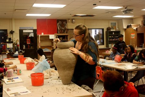"Sophomore Cora Dean-Wyatt sculpts her current piece in ceramics class. Two years in a row, Dean-Wyatt's sculptures have been selected to be part of the Viva City Fine Arts Festival. ""[Ceramics] calms me down and is a thing that I can do to kind of helps me de-stress,"" said Dean-Wyatt."