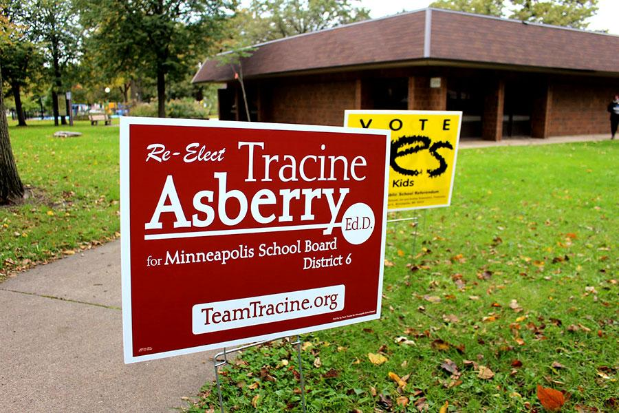 Signs set up by Tracine Asberry while campaigning in Linden Hills Park.